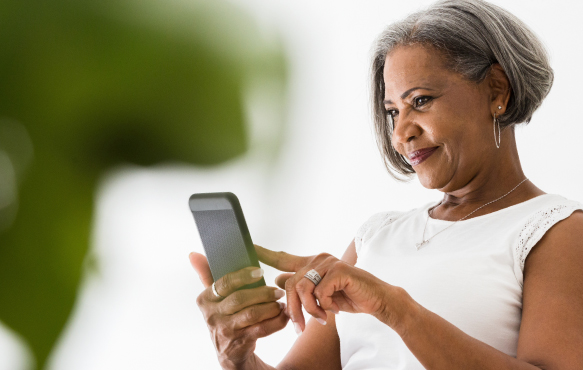 A mature black woman using her mobile phone